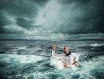 Ask for help during the storm. Man with lifesaver for help in a stormy sea royalty free stock photos