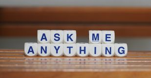 Ask me anything. Cube words on wood base background wallpaper Royalty Free Stock Photos