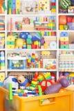 Ask med leksaker Arkivbild