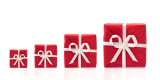 Ask  for more, four red gift boxes in a row. In different sizes,  isolated on white background with space for text (detailed large file Royalty Free Stock Image