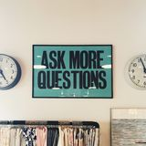 Ask More Questions Signage Stock Photography