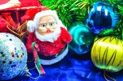 Ask och jul för jultomtendockagåva Arkivfoto