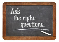 Ask the right questions. Motivational advice on a vintage slate blackboard Stock Photo