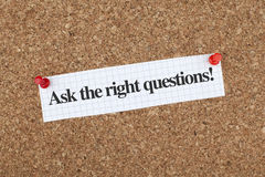 Ask The Right Questions. Note pinned on cork bulletin board Stock Photo