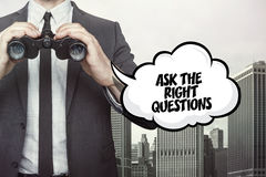 Ask the right questions text on blackboard with businessman. Ask the right questions text on  blackboard with businessman and key Stock Image