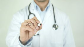 Ask your doctor, Doctor Writing on Transparent Screen. Man writing stock footage