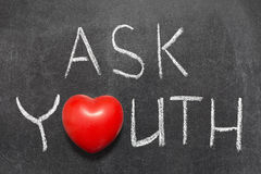 Ask youth. Phrase handwritten on blackboard with heart symbol instead of O royalty free stock photos