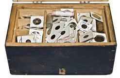 asken coins gammalt Arkivbilder