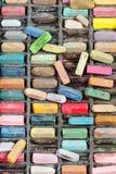 Asken med många använde konstnärliga torra pastell Arkivfoto