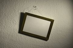 Askew picture frame on wall Stock Photos