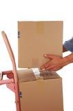 askhand som placerar lastbilen Arkivfoto