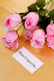 Asking For Forgiveness. With Note And Roses Royalty Free Stock Photography
