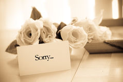 Asking For Forgiveness. With Roses On Table Royalty Free Stock Photography