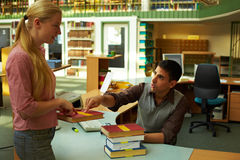Asking a librarian Stock Image