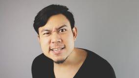 Asking for problem. An asian man with black t-shirt stock photos