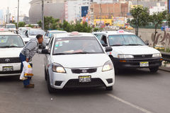 Asking for Taxi Fare in Lima, Peru. LIMA, PERU - JULY 21, 2013: Unidentified man asking a taxi for the fare on Av. Paseo de la Republica in the city center on Stock Photos