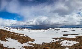 Askja caldera volcanic landscape with Herdubreid tuya mountain in background Highlands of Iceland Scandinavia. Panoramic view of Askja caldera with stormy clouds royalty free stock images