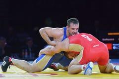 Aslan Abdullin (blauw hemd) versus Valery Gusarov Stock Foto
