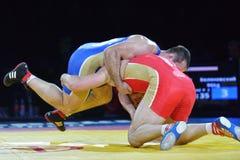 Aslan Abdullin vs Valery Gusarov (błękitny singlet) Obrazy Royalty Free