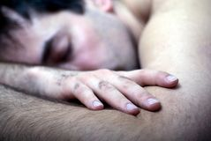 Asleep. A young caucasian man asleep on the bed Royalty Free Stock Images