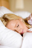 Asleep. A young woman in pyjamas asleep in bed Stock Images