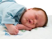 Asleep baby. isolated on white Royalty Free Stock Photo