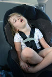 Asleep in the Car Seat. A little girl is fast asleep in her car seat Stock Photography