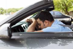 Asleep at driving wheel Stock Photo