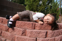 Asleep in the Garden. Young child sleeping in the garden stock photo