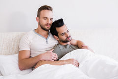 Asleep gay couple lying in bed Royalty Free Stock Photos