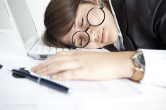 Asleep girl on the keyboard Stock Photography
