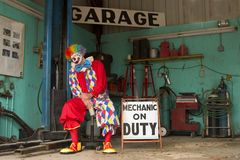 Asleep on the Job. Clown mechanic asleep on the Job Stock Photography