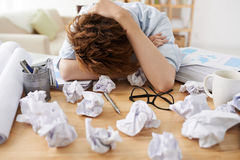 Asleep manager. Stressed financial manager fell asleep when working on report Royalty Free Stock Photo