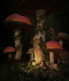 Asleep in the mushroom forest, 3d CG. 3d computer graphics of a sleeping fairy, who is watched by a cheeky imp and an owl Stock Image