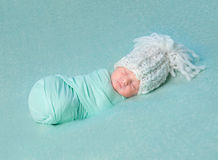 Asleep newborn baby in big hat Royalty Free Stock Image