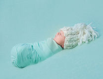 Asleep newborn baby in big hat Stock Photos