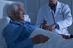 Asleep old patient being examined Royalty Free Stock Photo