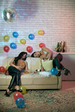 Asleep party girls. Asian female friends fell asleep at the party royalty free stock photography