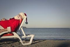 Asleep Santa Claus stock photos