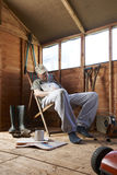 Asleep in shed. Man sitting in deckchair falling asleep in the shed stock photos
