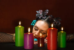 Asleep soothsayer. Young beautiful soothsayer sleeps about  five candles Royalty Free Stock Photography
