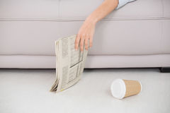 Asleep woman holding newspaper on sofa Royalty Free Stock Images