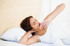 Asleep woman lying on her bed Stock Image