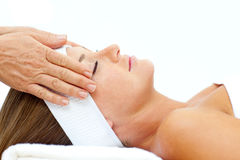 Asleep woman relaxing with head massage Royalty Free Stock Image