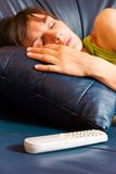 Asleep woman on the sofa Royalty Free Stock Images