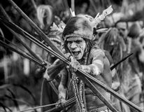Asmat tribe warrior with bow and arrow. Stock Images