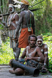 Asmat tribesman with drum. JOW VILLAGE, ASMAT, NEW GUINEA, INDONESIA -JUNE 28: Asmat tribesman with drum.The In the village of Asmates goes preparation for  of Stock Photography