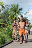 Asmats. JOW VILLAGE, ASMAT, NEW GUINEA, INDONESIA -JUNE 28:The Village follows the ancestors embodied in spirit mask as they tour the village the Doroe ceremony Royalty Free Stock Photo
