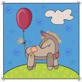 Asno do brinquedo no prado Imagens de Stock Royalty Free