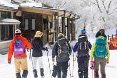 ASO-KUJU NATIONAL PARK, OITA, JAPAN - FEBRUARY 12, 2017: A Snowy. Hikers return from a trek through the Kuju mountain range in Aso-Kuju National Park in Oita royalty free stock photo